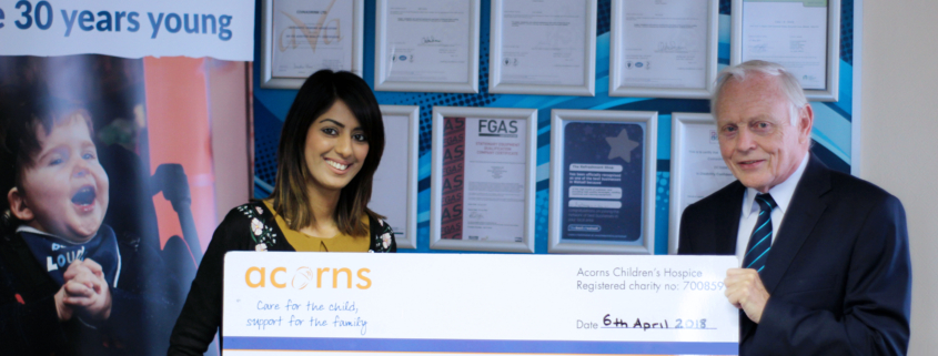 MD Roger Williams presenting the cheque to Acorns Children's Hospice.