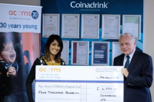 Presenting the cheque to Acorns Children's Hospice.