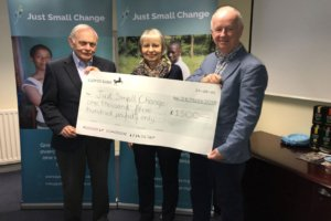 Presenting the cheque to Just Small Change after Party Night in 2018.